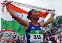 hima das is celebrating after winning the gold track